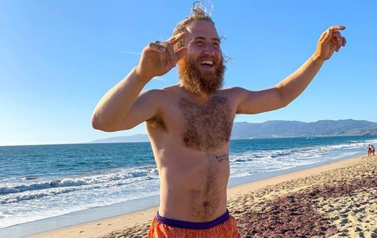Mike Posner at the beach in California