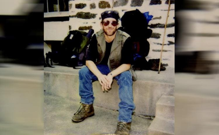 Baltimore Jack sitting on a ledge at the Appalachian trail entrance in 1995