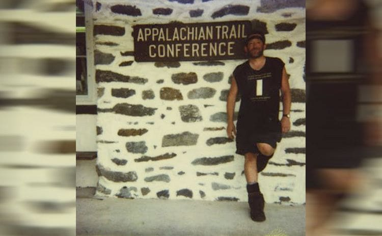 Baltimore Jack standing against the wall next to the Appalachian Trail Conference sign