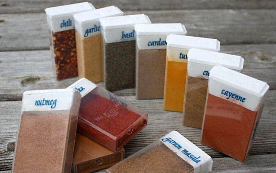 Empty Tic-Tac bottles being used to hold spices