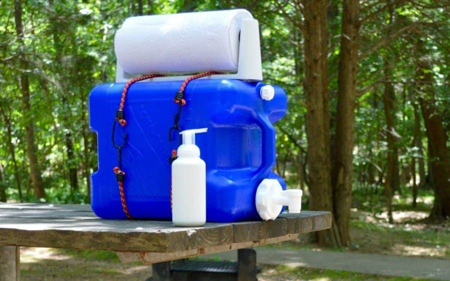 Plastic laundry detergent dispenser is being used as a hand wash station