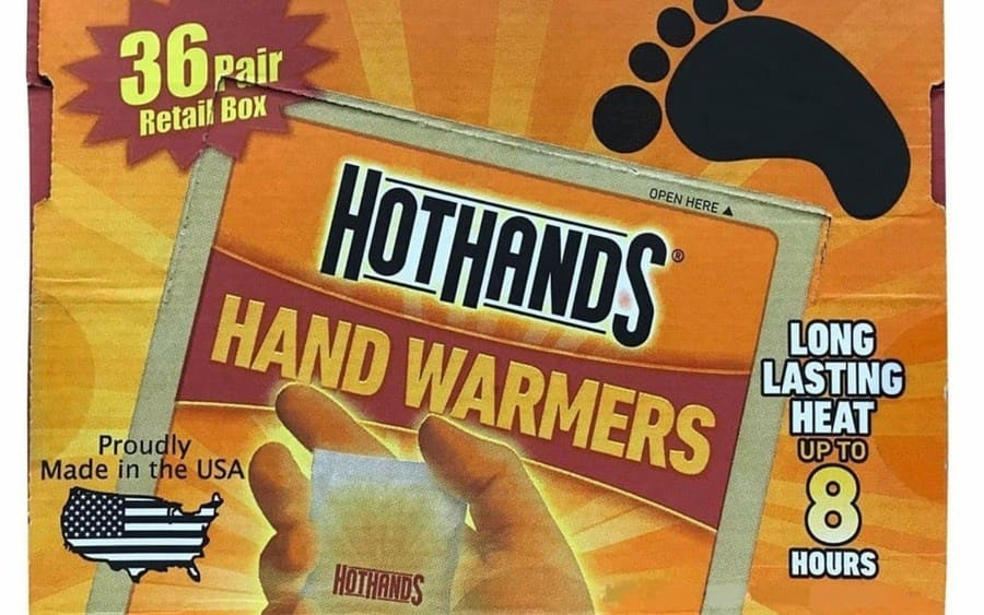 A packet with a heat bag inside, with 'HotHands' inscribed on the packet.