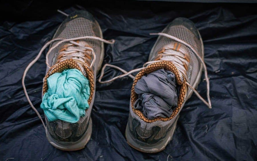 Hiking shoes stuffed with clothing