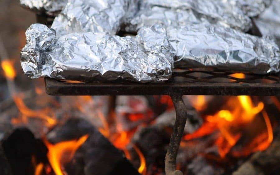 Food wrapped in tinfoil on a fire