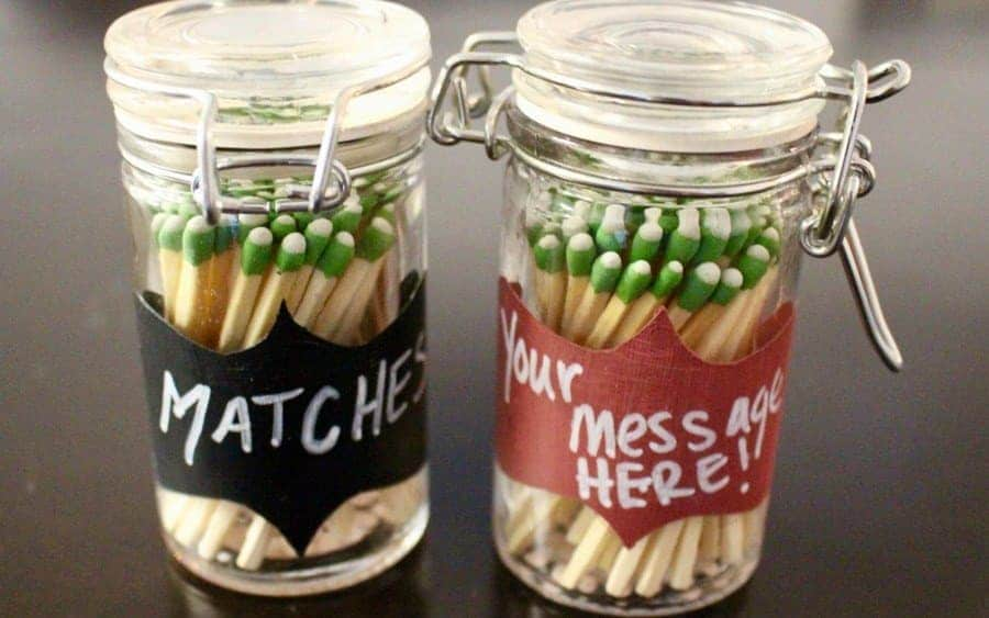 a small jar containing matches