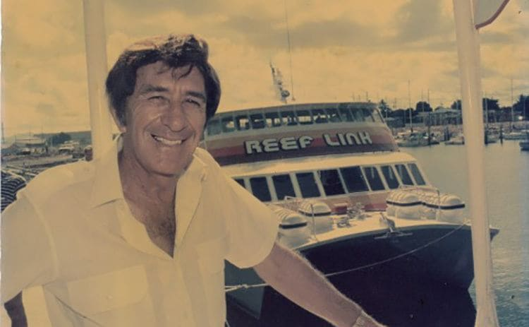 Doug Tarca next to a boat