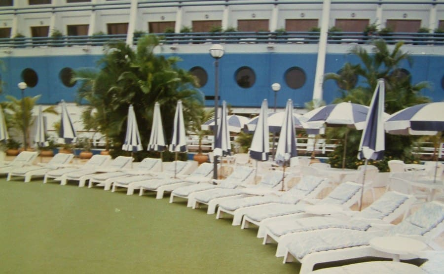 A view of chairs set up around a pool at the floating hotel