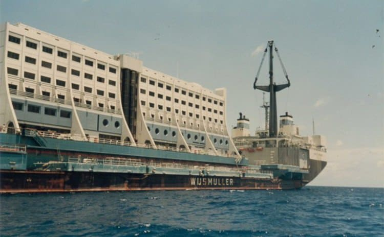 The floating hotel looking a bit run down with rust all around the bottom of it