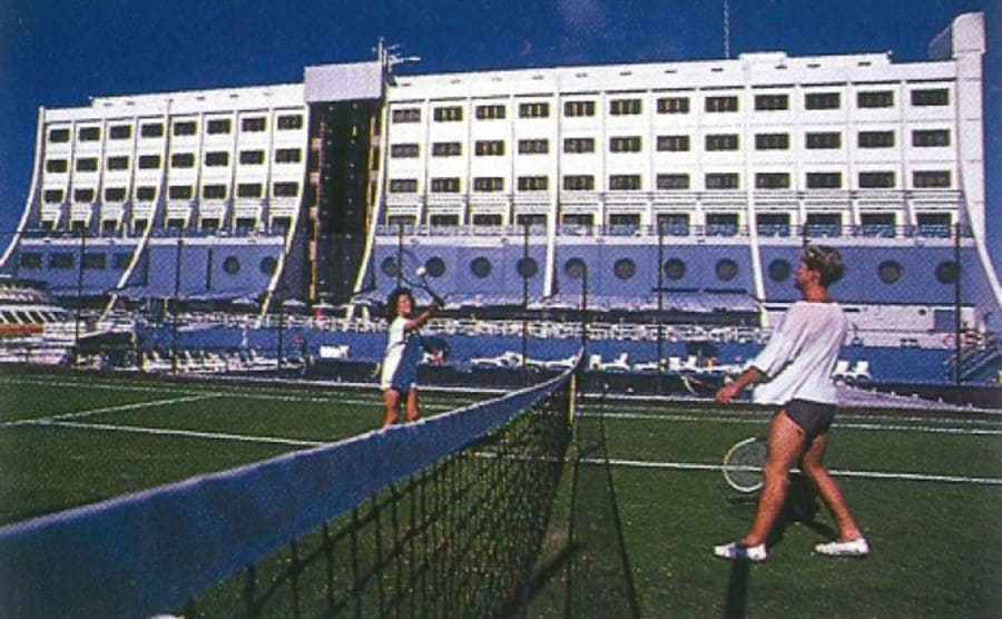 Women playing tennis at the hotel's tennis court