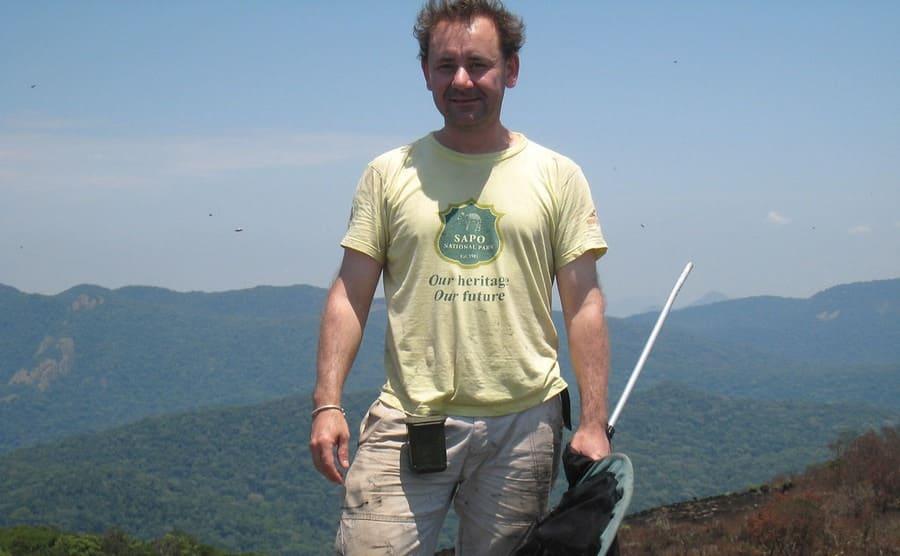 Dr. Julian Bayliss on the summit of Mt Mabu