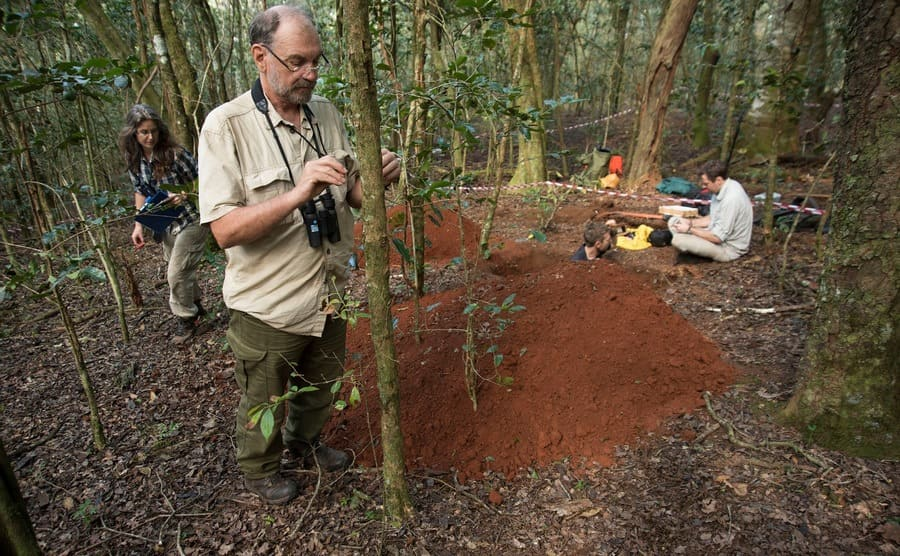 Scientists dig and take different samples from around the mountain