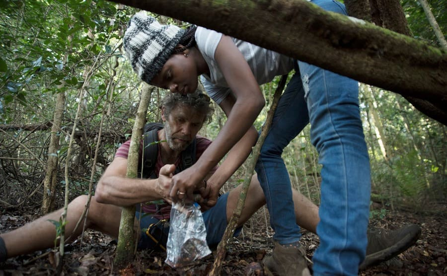 Mike Robertson and Ana Gledis da Conceico-Mirando are collecting samples that seemed to have come from a small forest antelope