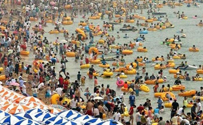 A beach crowded with people