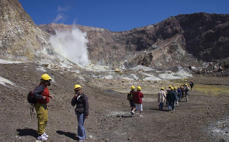 Tourists walking a trail on White Island