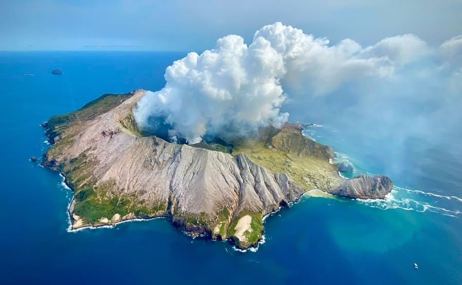 An aerial view of White Island volcano steaming