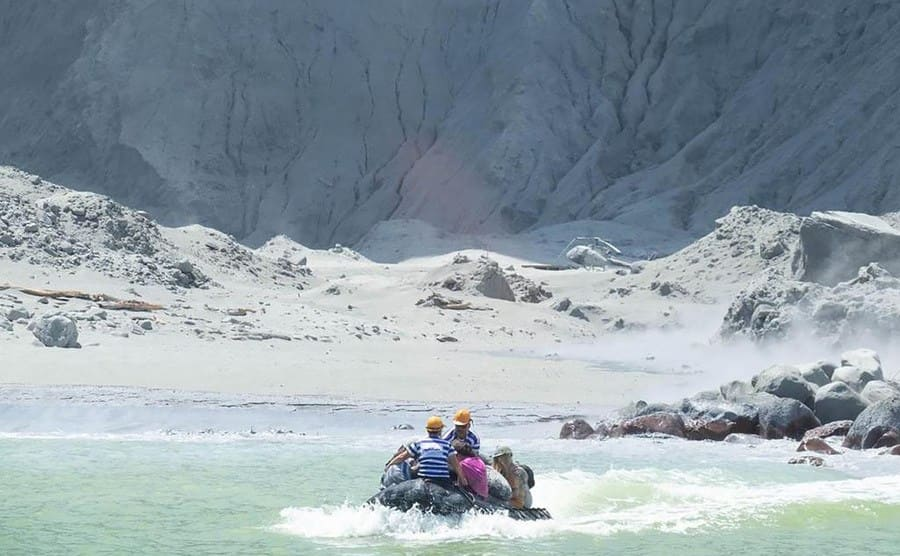 People on a blow-up raft rescuing injured tourists from the Island