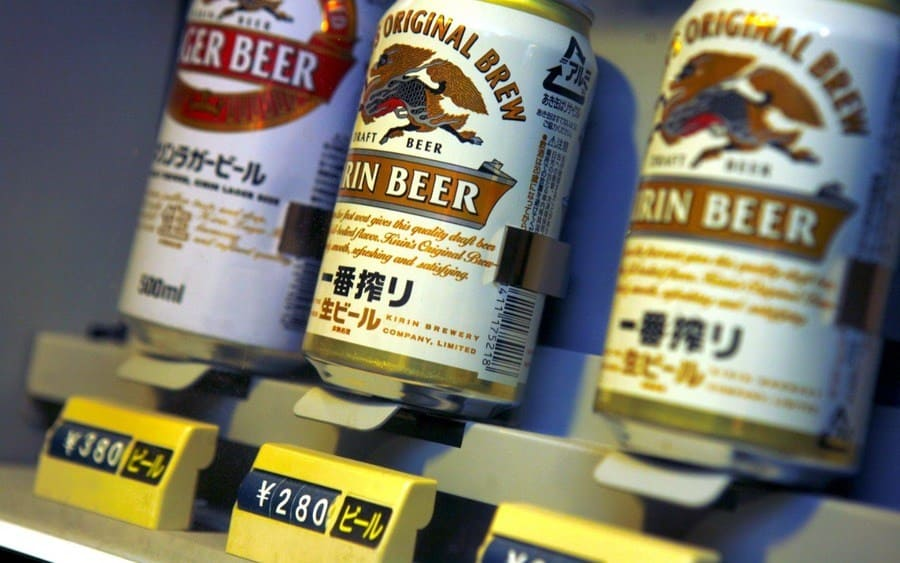 Japanese 'Kirin' beer cans on sale in a vending machine.