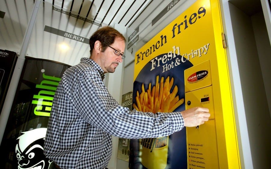 A vending machine that delivers French fries with 30% less fat, prepared in approximately 1 minute, without oil.