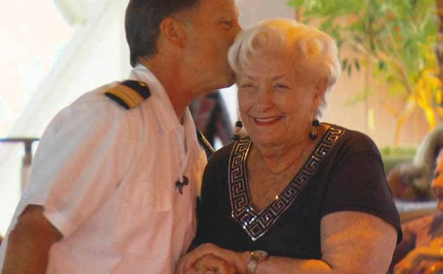Lee Wachtstetter receiving a kiss on the forehead from the ship's captain