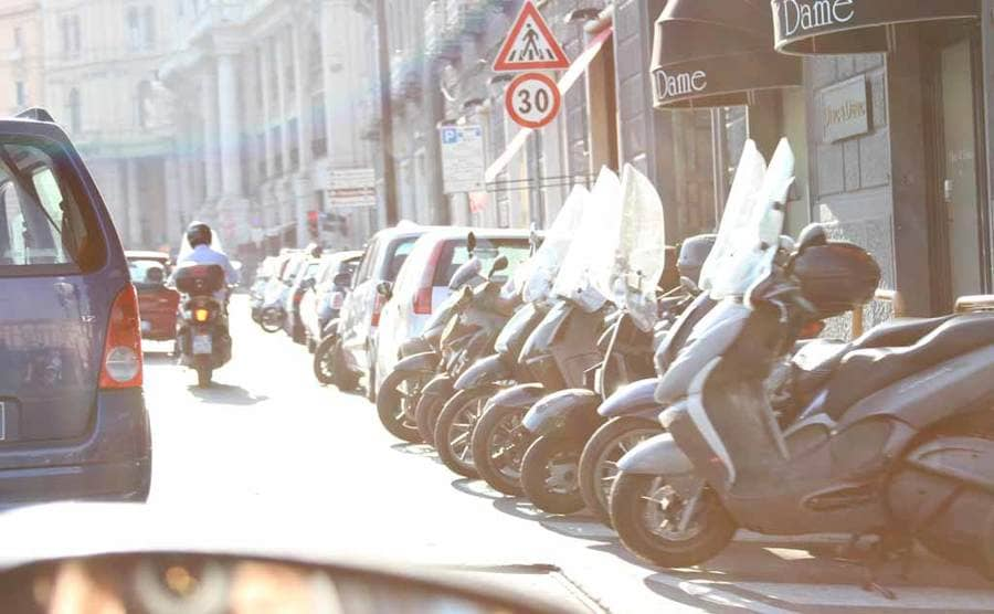 A photograph that Christian took in Italy from inside a car on the road with motorcycles lining the side of the road