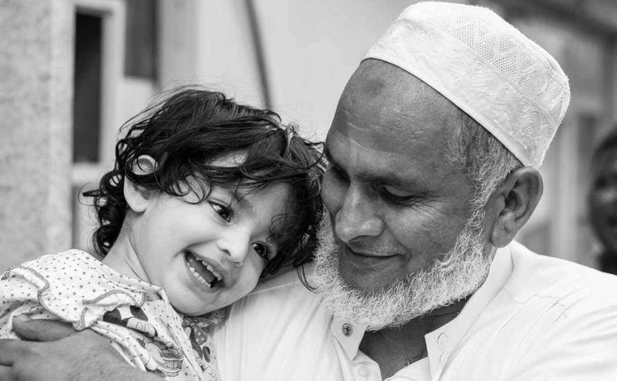 A photograph Christian took in Bahrain of an older gentleman and a young child smiling together