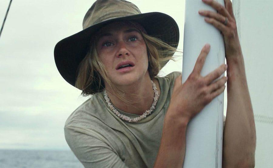 Shailene Woodley leaning on a pole