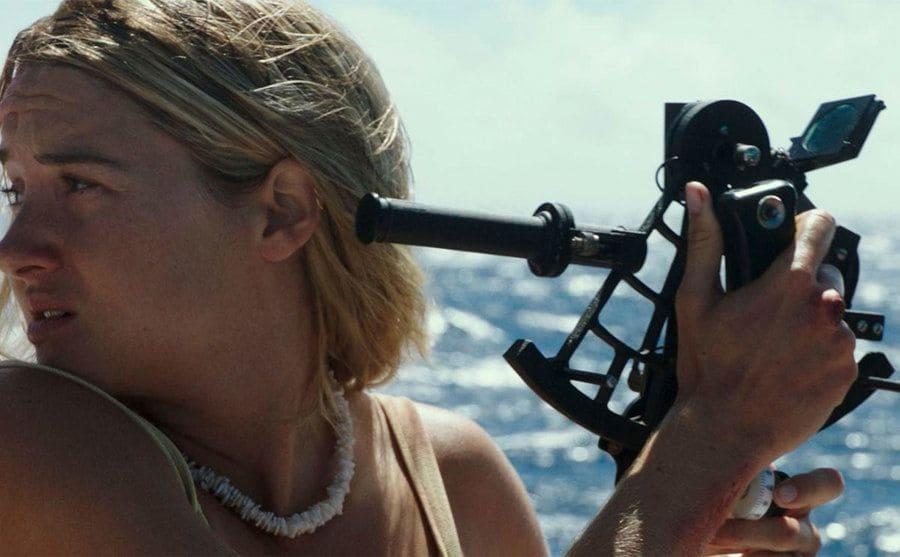 Shailene Woodley holding a sextant