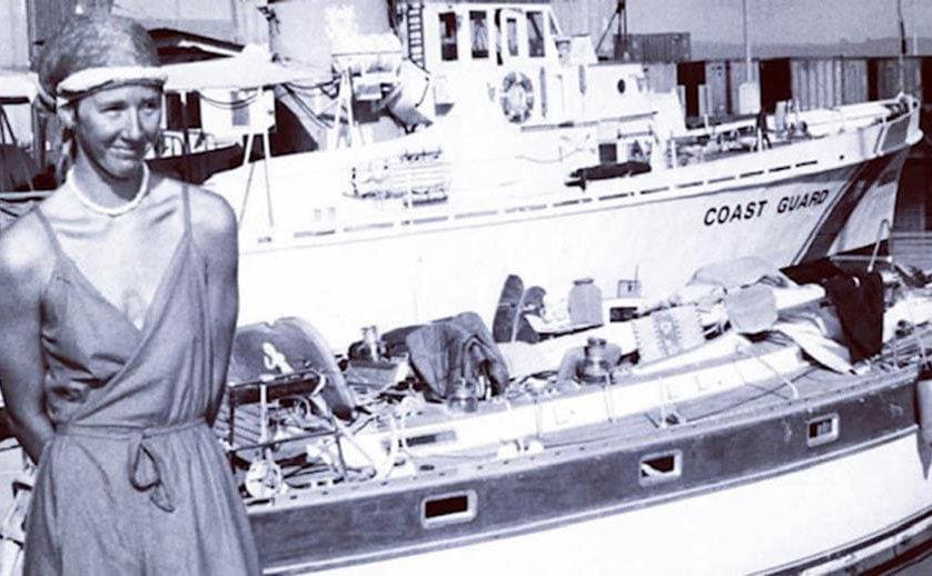 Tami Oldham standing in front of a coast guard boat