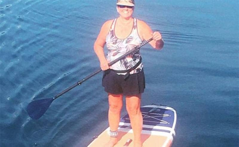 Tami Oldham rowing on her board