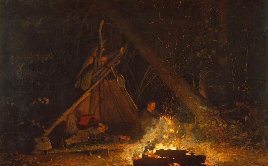 Men by a campfire and a make-shift tent