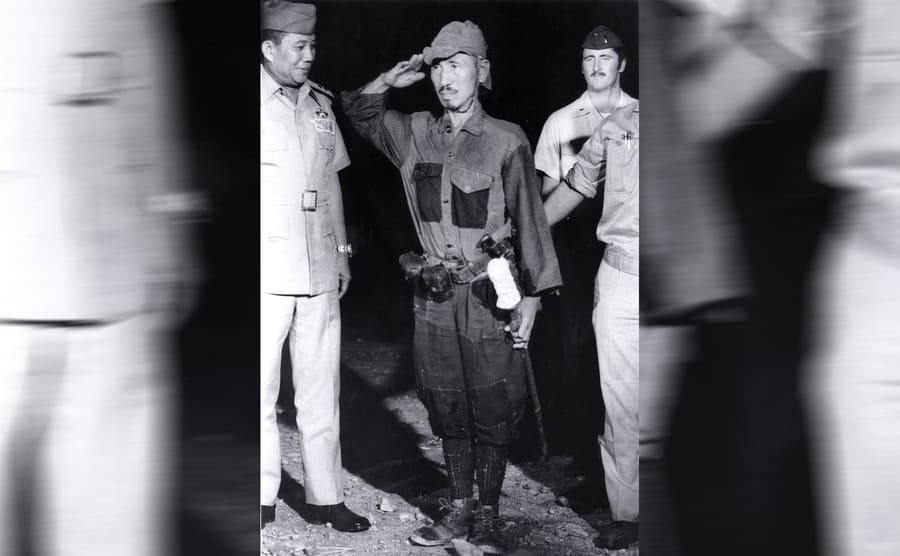 Hiroo Onoda saluting with soldiers around him