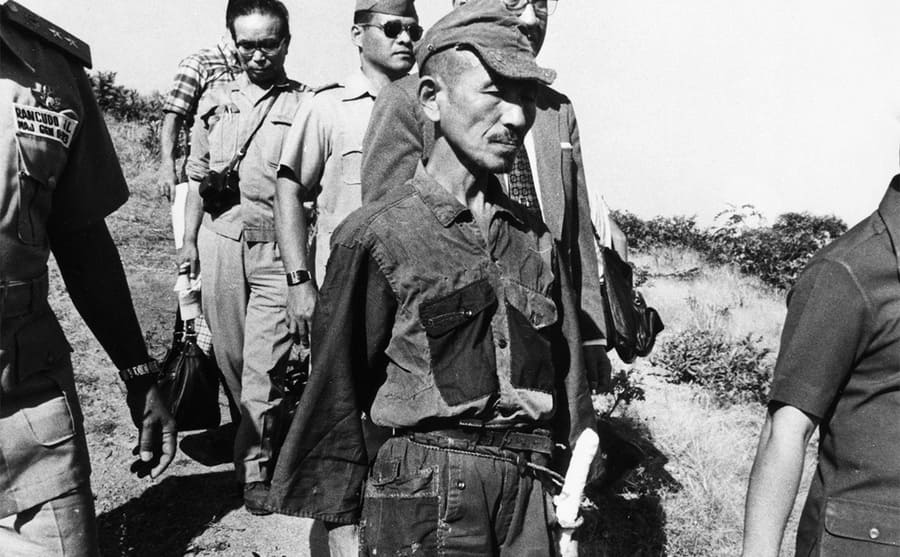 Hiroo Onoda walking with others while he surrendered in the Philippines in 1974