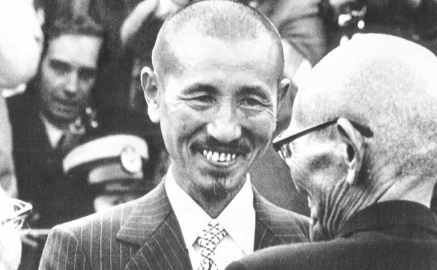 Hiroo Onoda smiling and greeting someone