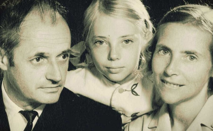 Juliane as a young girl posing with her parents