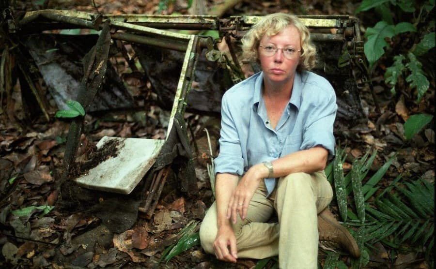Juliane sitting next to run-down plane seats at the site of the crash