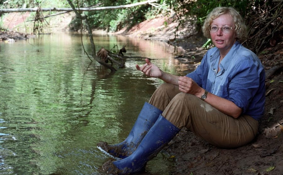 Juliane sitting by the stream in the rainforest