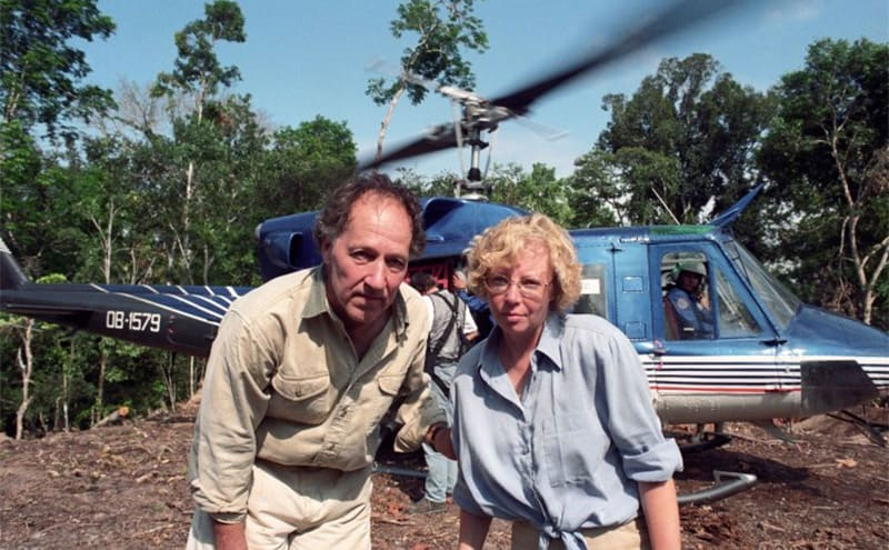 Juliane and a man posing outside of a helicopter at the crash site