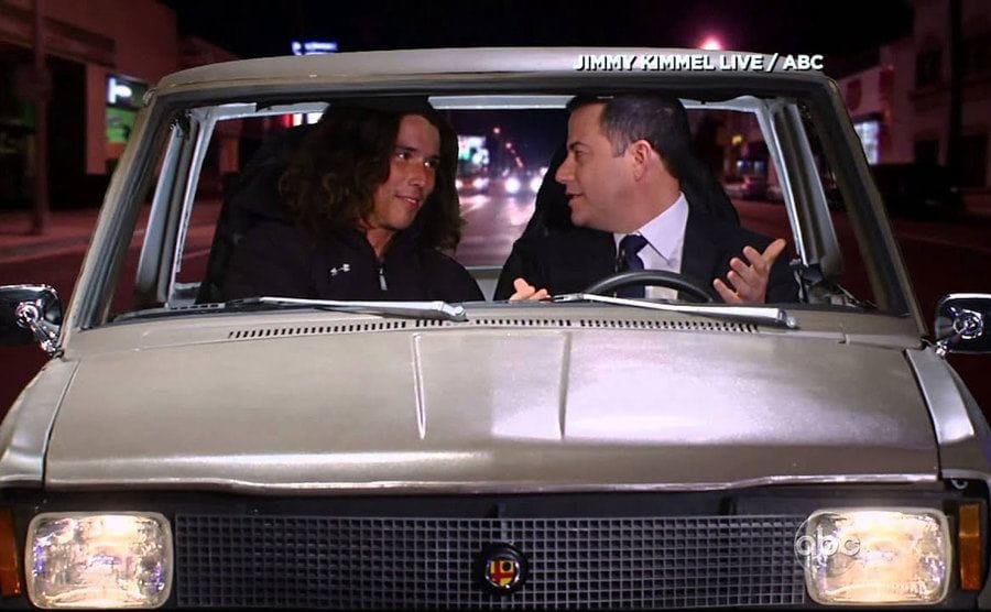Kai and Jimmy Kimmel in a car doing a sketch for Jimmy Kimmel Live