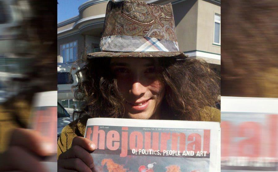 Kai holding the journal magazine