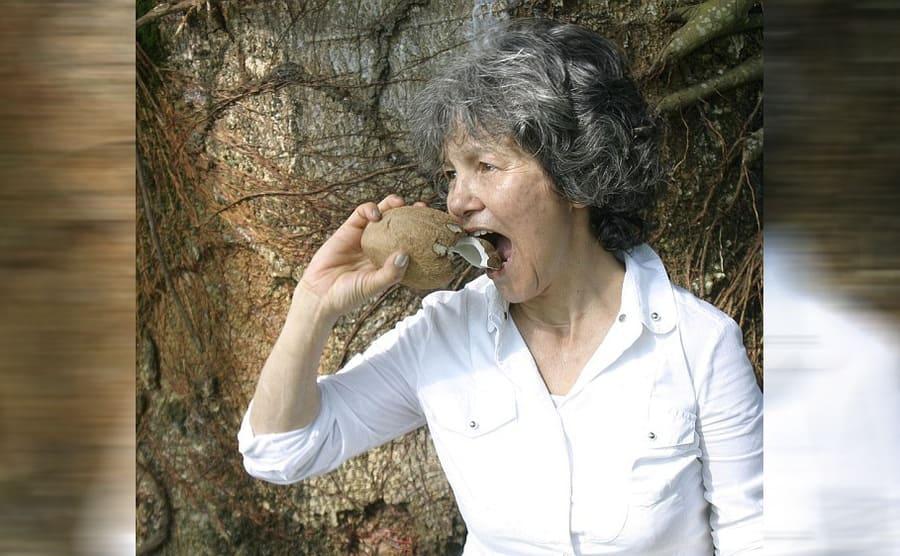 Marina biting on a coconut