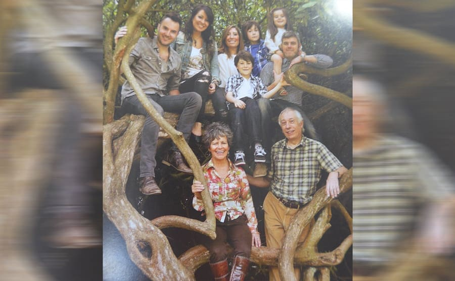 Marina and her family posing in the woods where she lived for years