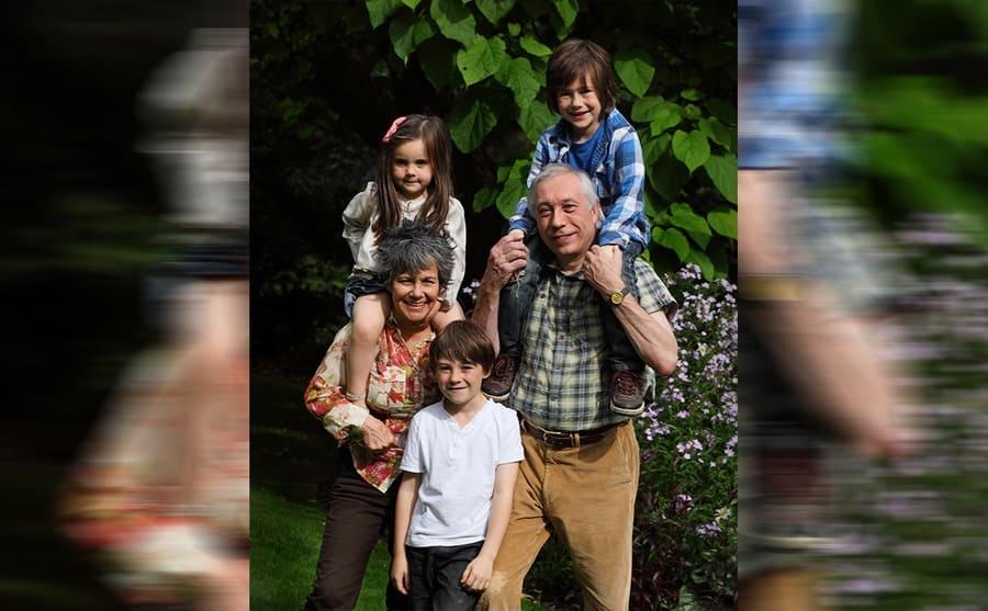 Marina and John with their grandchildren