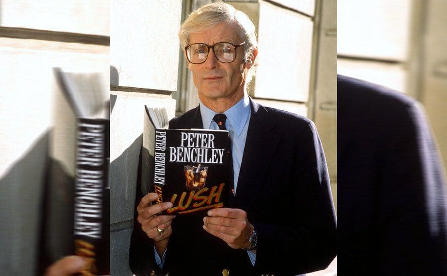 Peter Benchley holding his book titled 'Lush.'