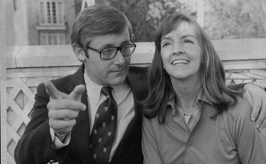 Peter Benchley and his wife Wendy posing together on a bench
