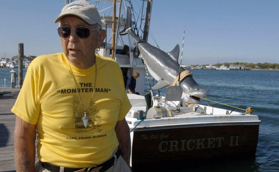 Frank Mundus posing next to his boat named Cricket II