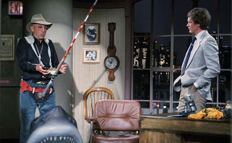 Frank Mundus with his fishing pole explaining something to David Letterman