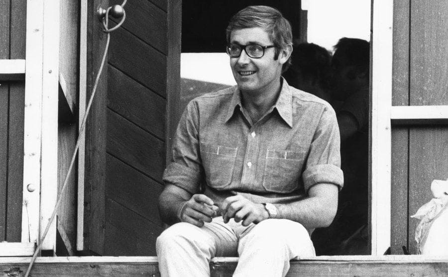 Peter Benchley sitting on a dock