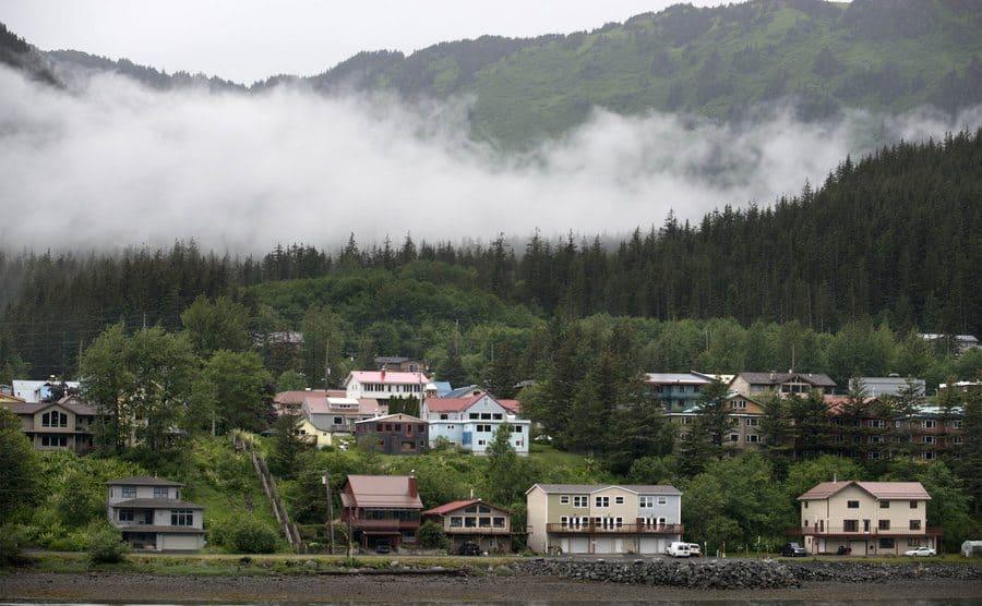 Landscape of Coastal Mountains, houses, and glaciers north of Juneau, Southeast Alaska