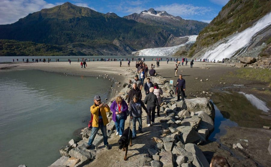 Tourists crowding the hikes and trails of Alaska during the busy season.