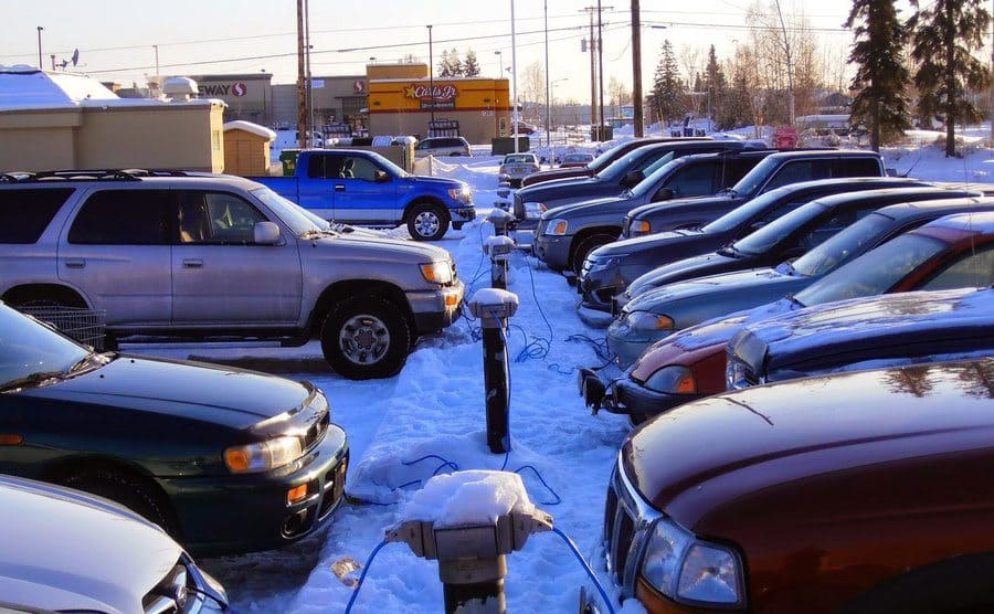 Multipul cars pluged into heaters on the street